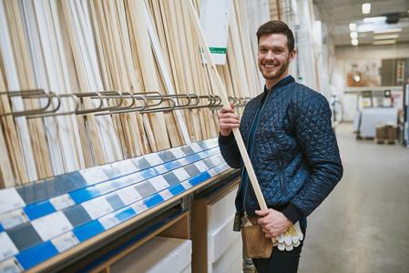 Happy confident young carpenter or handyman