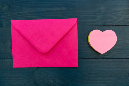 Love letter in pink envelope with love heart shape