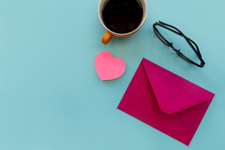 Love letter in pink envelope with love heart shape and coffee cu