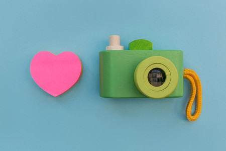 Love photography with pink heart shape and retro camera