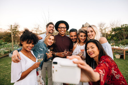 Group selfie at outdoor party
