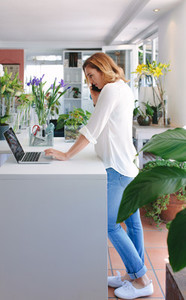 Female florist taking order in phone