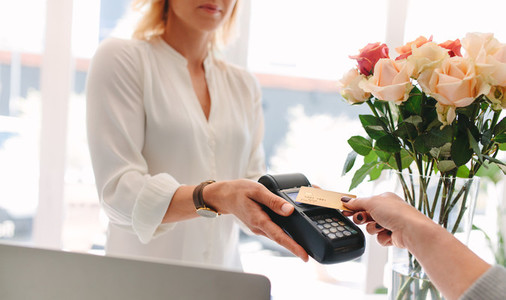 Paying through contactless card and NFC technology at flower sho
