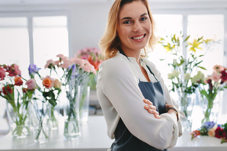 Happy and confident florist owner
