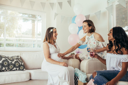 Group of female friends meeting for baby shower