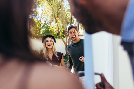Couple attending friends housewarming party