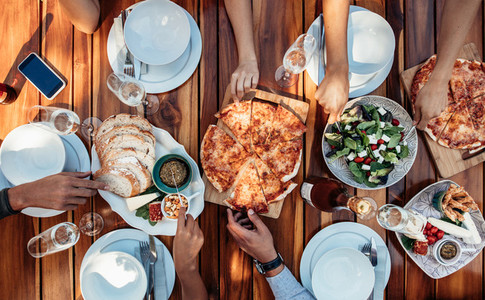 Friends having pizza at party