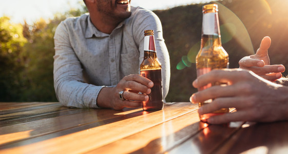 Couple having beers at outdoor party