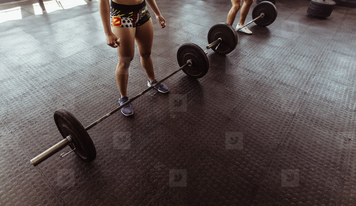 People at gym workout with heavy weights