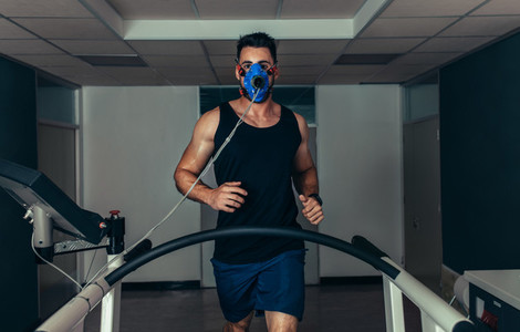 Runner testing his performance in sports science laboratory