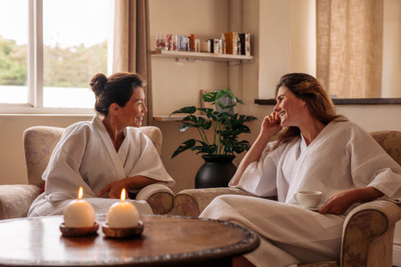 Female friends chatting while waiting for spa
