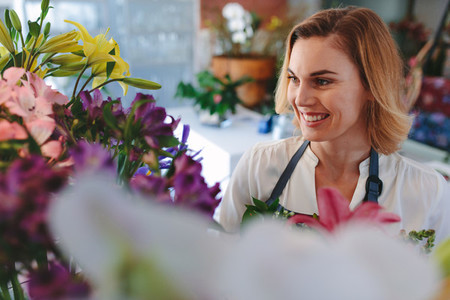 Beautiful caucasian woman in flower shop