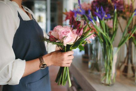 Female florist hands holding flowers