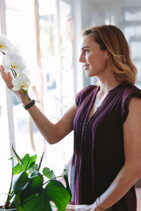 Florist owner touching flowers
