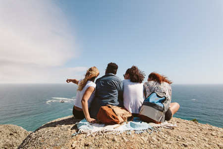 Group of friends enjoying view from top of a hill