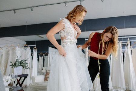 Making adjustment to wedding gown
