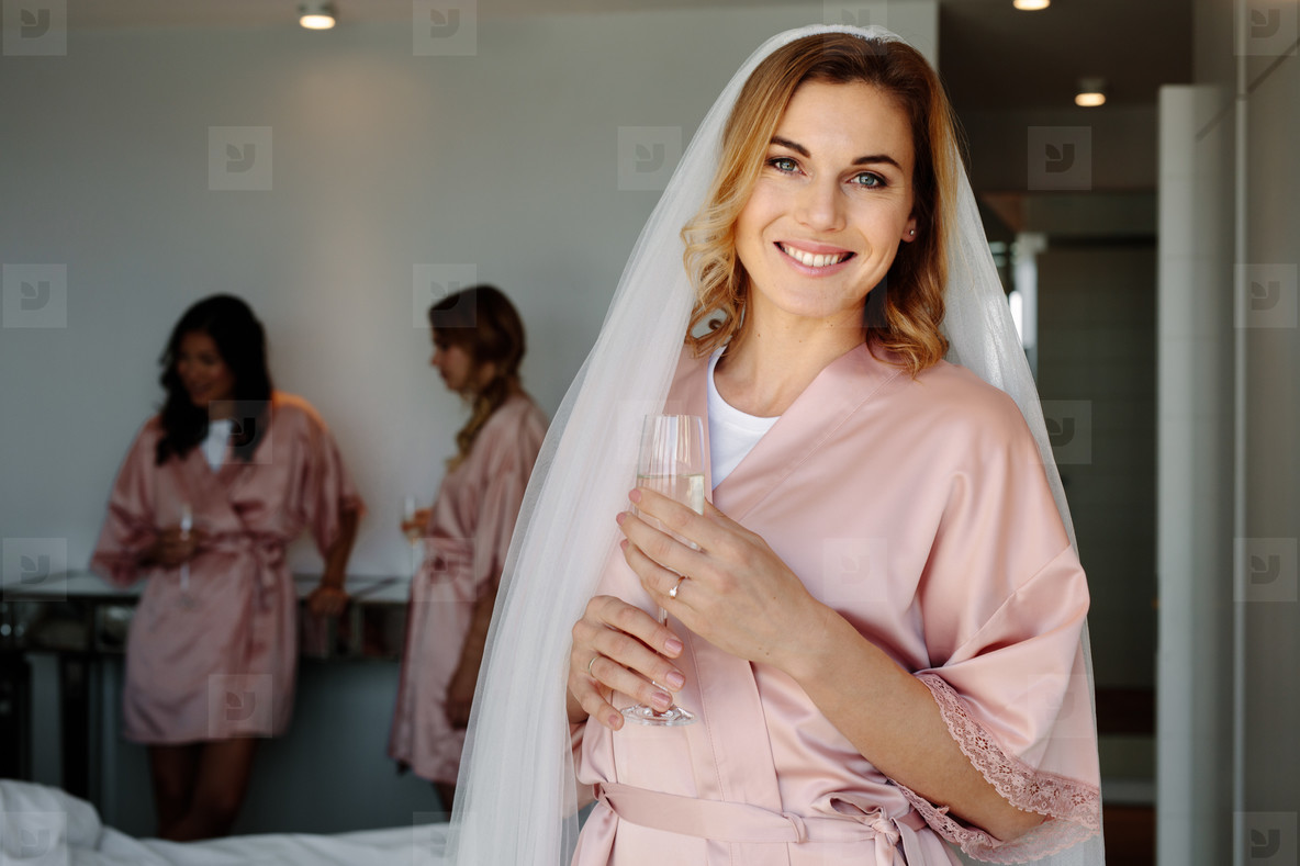 Bride celebrating her bachelorette party with friends at home