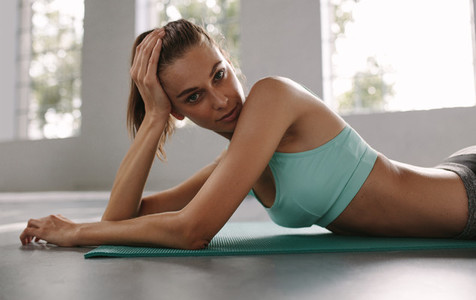 Woman taking rest after exercising in health club