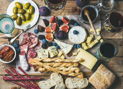 Wine  snack set with meat  bread  olives  sun dried tomatoes  berries