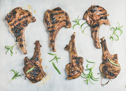 Grilled lamb ribs with fresh rosemary in metal baking tray