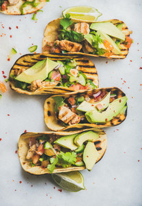 Healthy corn tortillas with grilled chicken  avocado and fresh salsa