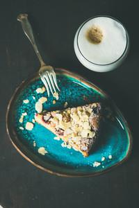 Piece of lemon ricotta almond raspberry cake with coffee