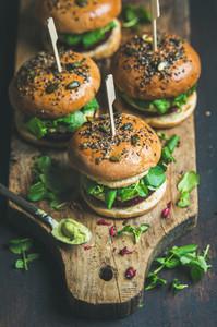 Healthy vegan burger with beetroot  quinoa patty  arugula  avocado sauce