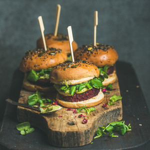 Healthy homemade vegan burger with beetroot quinoa patty and arugula