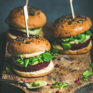 Healthy vegan burger with beetroot quinoa patty and avocado sauce