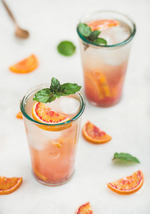 Blood orange fresh summer homemade lemonade with ice and mint