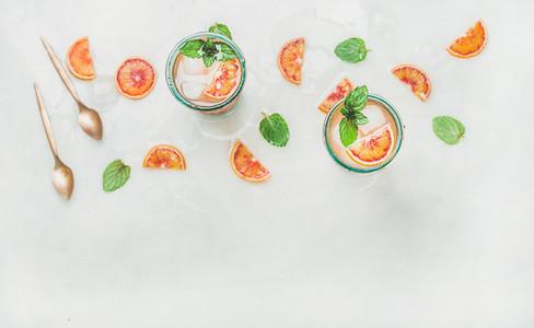 Homemade blood orange lemonade in glasses  copy space