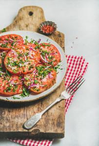 Fresh heirloom tomato  parsley and onion salad  Vegan food concept