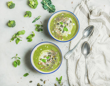 Spring healthy broccoli cream soup with mint and coconut cream