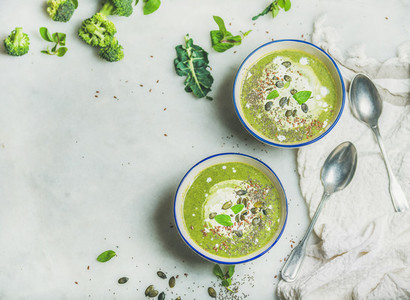 Broccoli cream soup with mint and coconut cream copy space