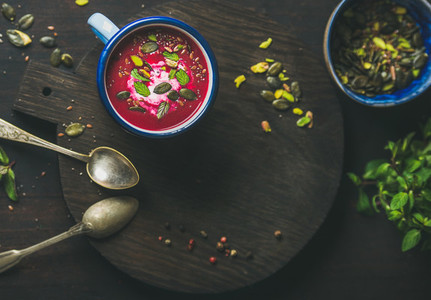 Dieting beetroot soup with mint pistachio and seeds copy space