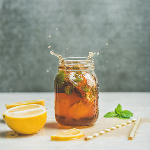 Summer Iced tea with lemon and herbs square crop