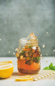 Summer cold Iced tea with lemon and herbs