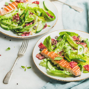 Healthy spring salad with grilled salmon  orange and quinoa