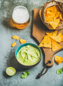 Mexican corn chips  fresh guacamole sauce and glass of beer