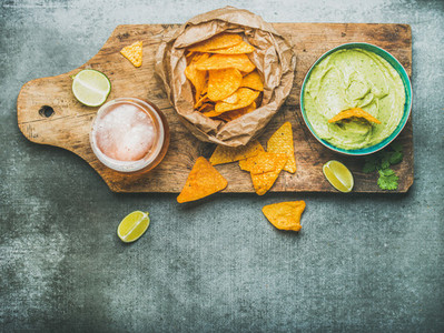 Guacamole sauce corn chips beer in glass top view
