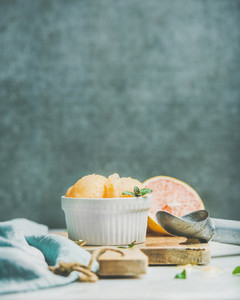 Pink grapefruit sorbet with mint in bowl  copy space