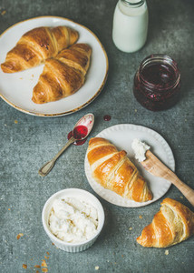 Freshly baked croissants with jam  ricotta cheese and milk
