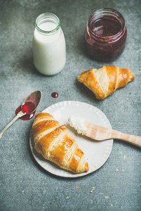 Croissants with raspberry jam  ricotta cheese and milk