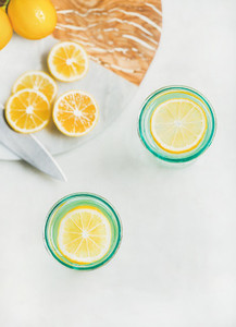 Detox lemon water in glasses  top view  copy space