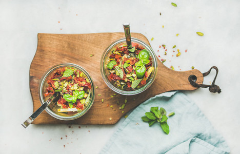 Healthy salad with quionoa  avocado  dried tomatoes in glass jars