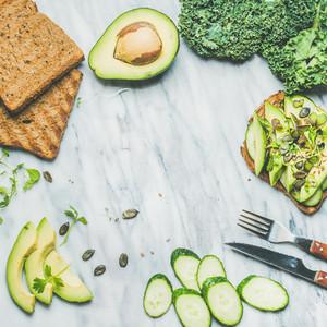 Avocado  cucumber  kale  kress sprouts  pumpkin seeds sandwich  square crop