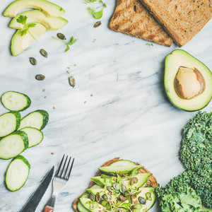 Sandwich with avocado  cucumber  kale  kress sprouts  pumpkin seeds