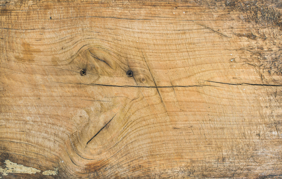 Old rustic discolored wooden board texture