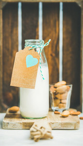 Fresh vegetarian dairy free almond milk served with nuts