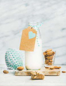 Fresh vegan dairy free almond milk with craft paper label